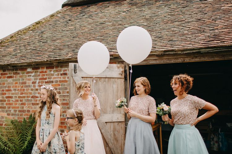 Bridesmaids With Balloons Wearing Coast
