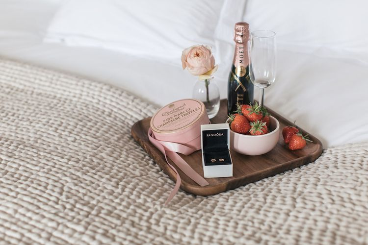 PANDORA rose gold earrings and breakfast tray
