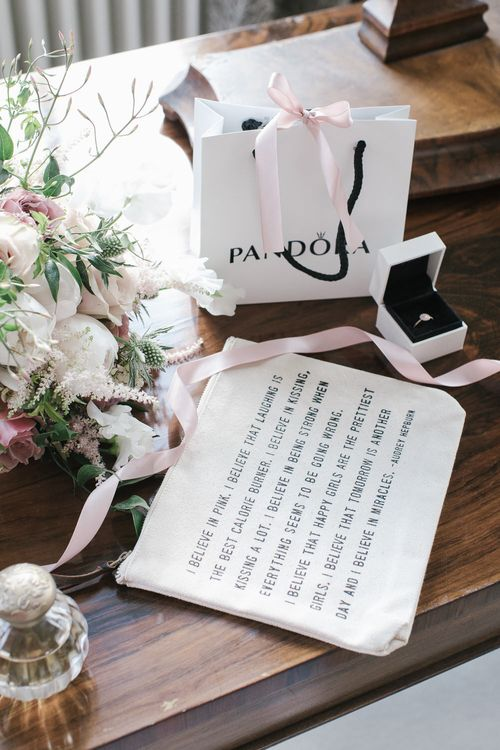 Makeup bag and PANDORA ring