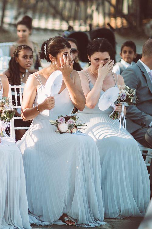 Emotional Bridesmaids wearing Pale Blue Pleated ASOS Dresses