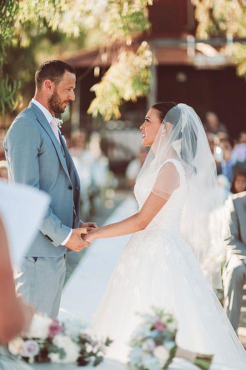 Bride & Groom during the Outdoor Wedding Ceremony