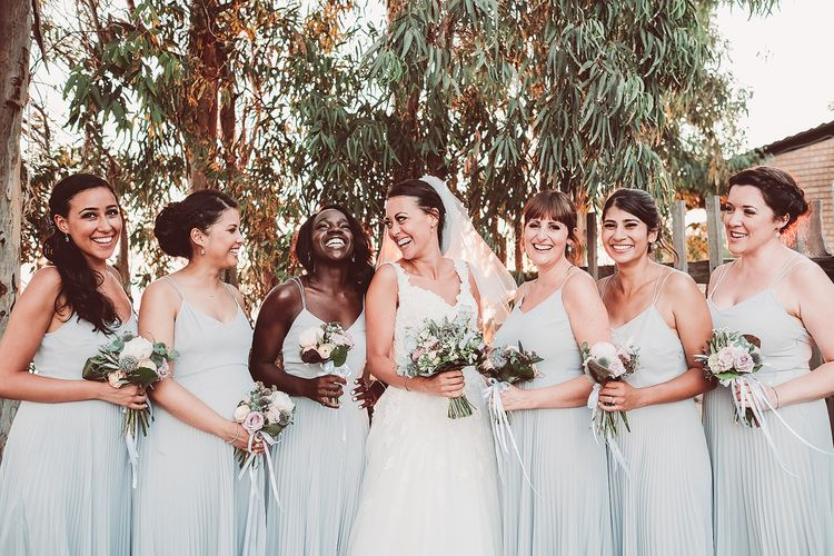 Bridesmaids in Pale Blue Pleated Skirt Dresses from ASOS