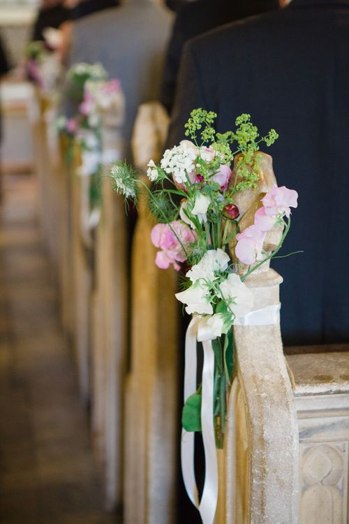 Pew Flowers | Bride in Ingrida Bridal Gown | Beautiful Classic Wedding at Cornwell Manor | Lucy Davenport Photography