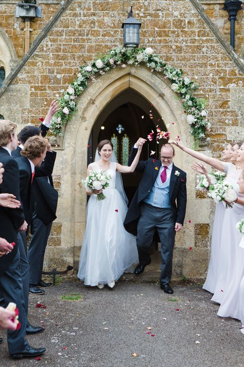 Confetti Exit | Bride in Ingrida Bridal Gown | Groom in Tails | Beautiful Classic Wedding at Cornwell Manor | Lucy Davenport Photography