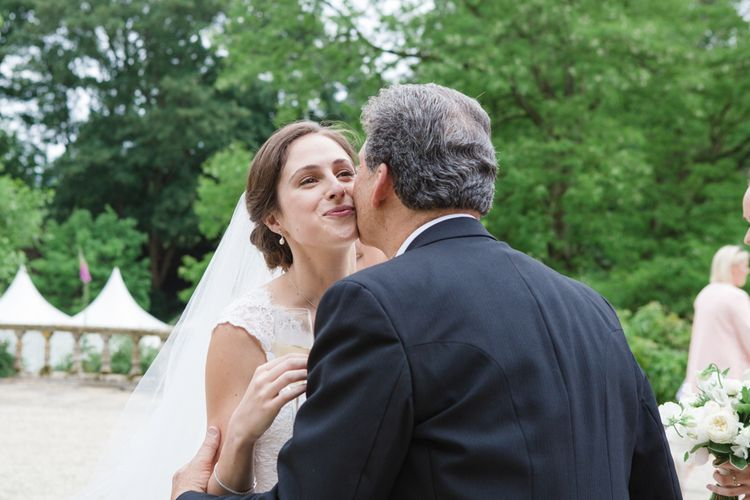 Wedding Guests Hugs | Bride in Ingrida Bridal Gown | Beautiful Classic Wedding at Cornwell Manor | Lucy Davenport Photography