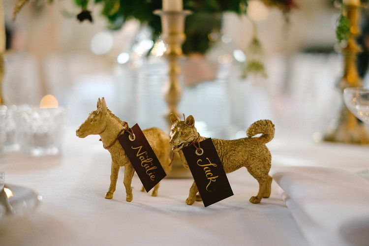 Gold Spray Painted Animal Place Settings | Natalie Hewitt Planned Wedding at Normanton Church & Kingsthorpe Lodge Barn | Jeni Smith Photography | Blue Ridge Wedding Videography