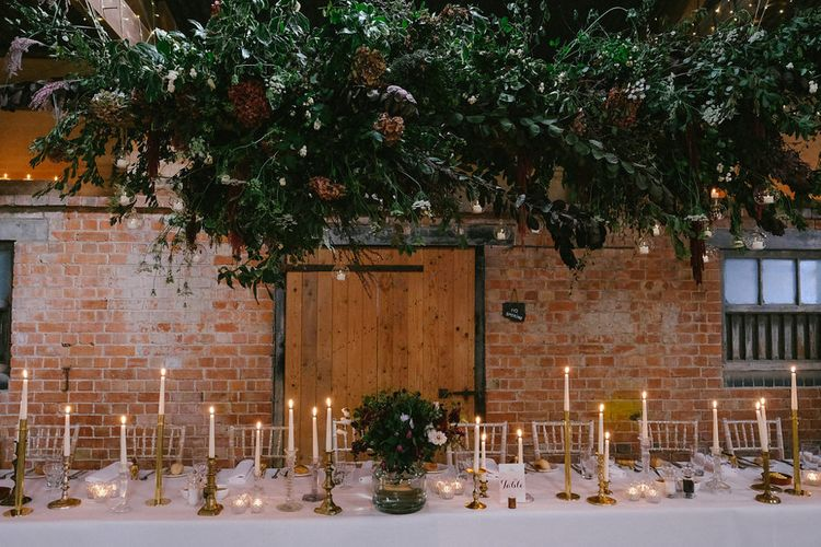 Top Table with Floral Hanging Installation & Candlelight | Natalie Hewitt Planned Wedding at Normanton Church & Kingsthorpe Lodge Barn | Jeni Smith Photography | Blue Ridge Wedding Videography