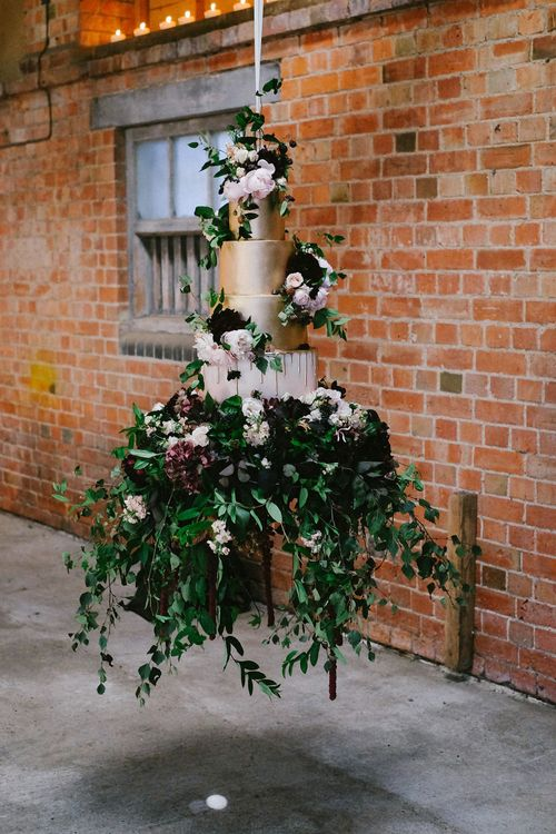 Suspended Wedding Cake by Couture Cakes | Jay Archer Floral Design | Natalie Hewitt Planned Wedding at Normanton Church & Kingsthorpe Lodge Barn | Jeni Smith Photography | Blue Ridge Wedding Videography