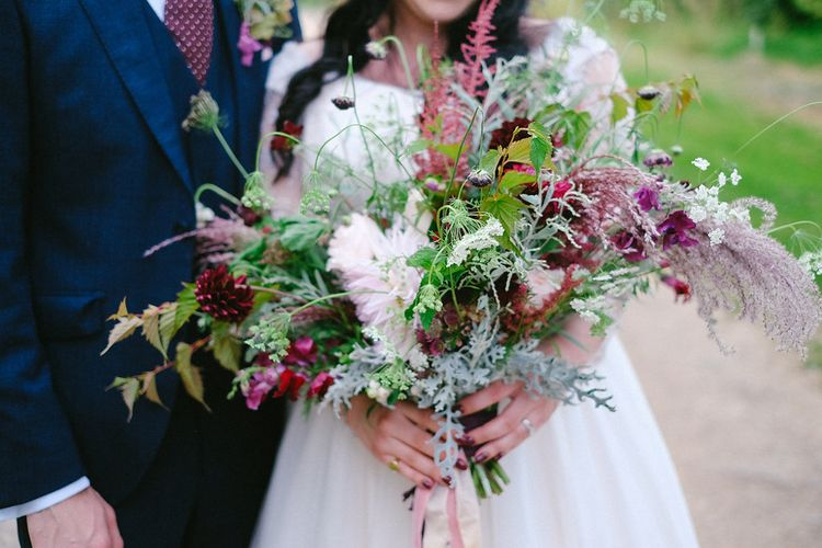 Red & Green Oversized Bouquet | Boho Bride in Naomi Neoh Gown | Groom in Hackett Suit | Natalie Hewitt Planned Wedding at Normanton Church & Kingsthorpe Lodge Barn | Jeni Smith Photography | Blue Ridge Wedding Videography