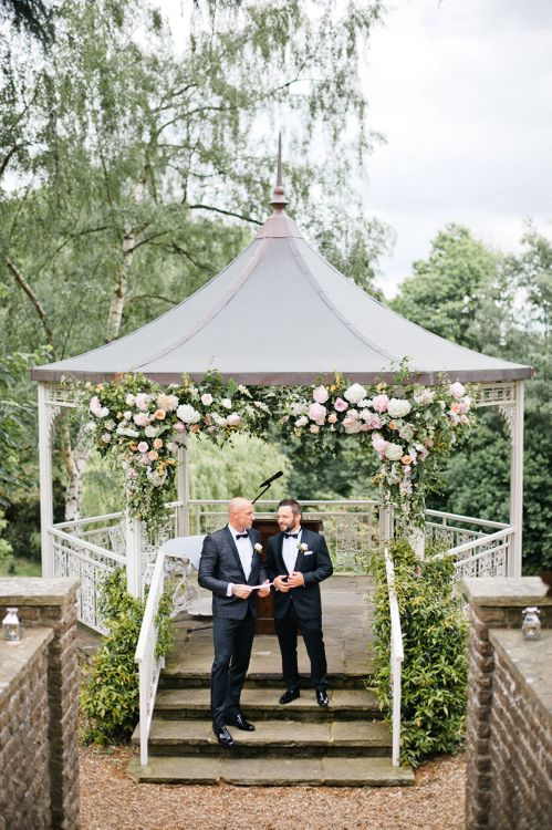 Arbour Flowers | Groom in Dolce & Gabbana Suit | Outdoor Blush Flower Filled Wedding at Pennyhill Park, Surrey Planned by Something Blue Weddings | Anushe Low Photography | Reel Weddings Film