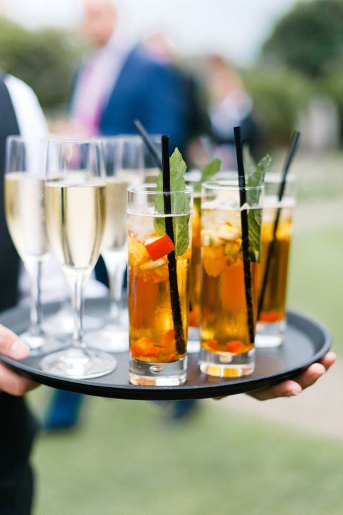 Pimms Drinks Reception | Outdoor Blush Flower Filled Wedding at Pennyhill Park, Surrey Planned by Something Blue Weddings | Anushe Low Photography | Reel Weddings Film