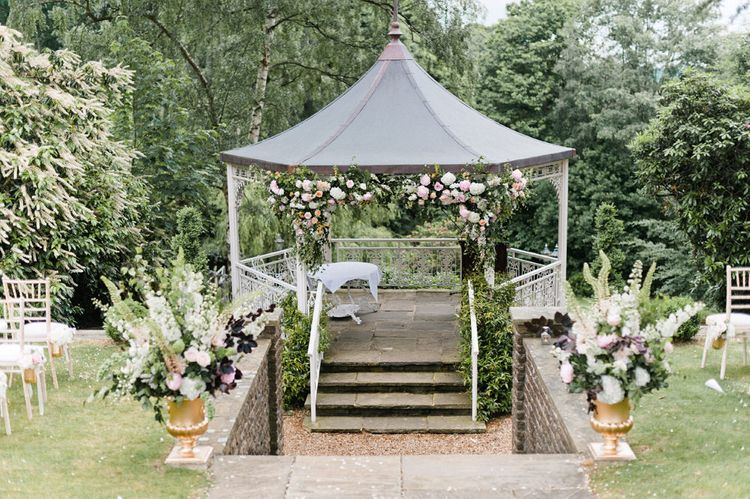 Blush Flower Covered Arbour by Blue Sky Flowers | Pennyhill Park Wedding, Surrey, Planned by Something Blue Weddings | Anushe Low Photography | Reel Weddings Film