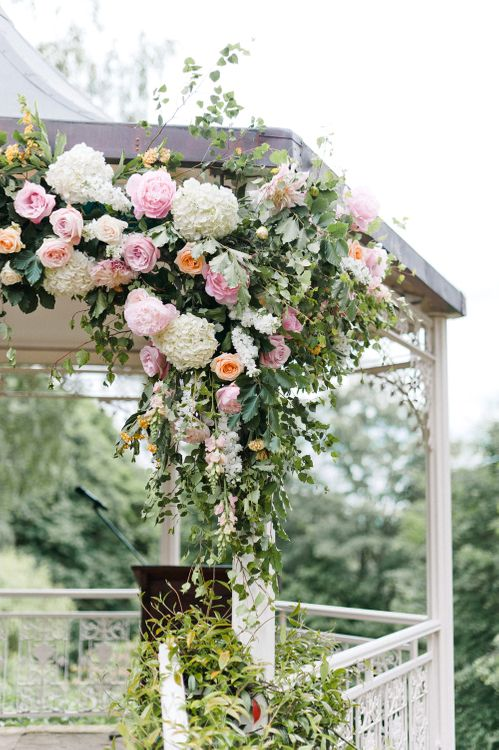Pink, White & Green Flower Covered Arbour by Blue Sky Flowers | Pennyhill Park Wedding, Surrey, Planned by Something Blue Weddings | Anushe Low Photography | Reel Weddings Film