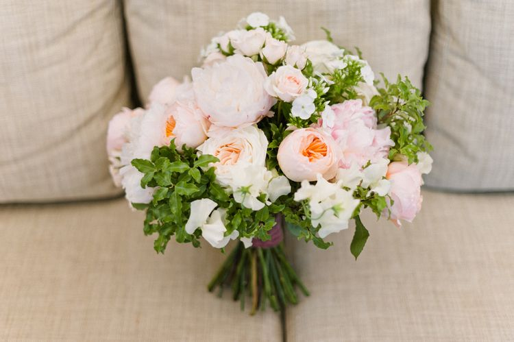 Blush Blue Sky Flowers Wedding Bouquet | Outdoor Blush Flower Filled Wedding at Pennyhill Park, Surrey Planned by Something Blue Weddings | Anushe Low Photography | Reel Weddings Film