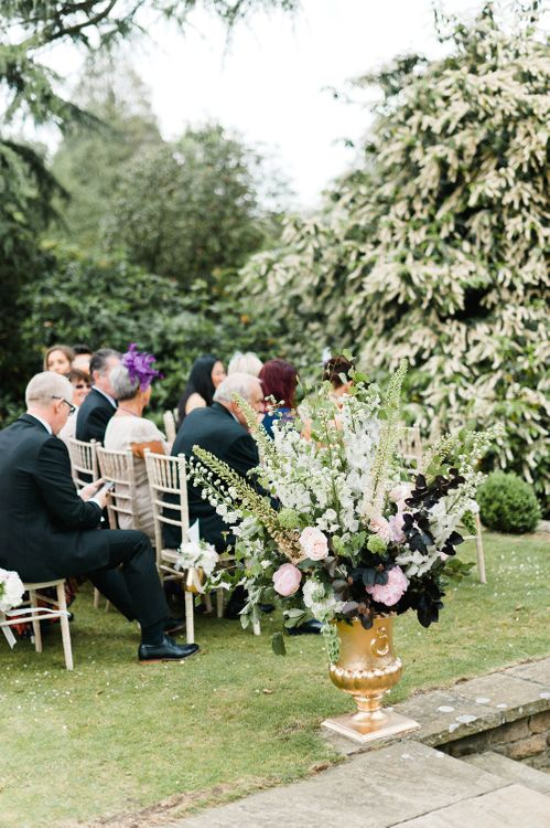 Floral Arrangement | Outdoor Blush Flower Filled Wedding at Pennyhill Park, Surrey Planned by Something Blue Weddings | Anushe Low Photography | Reel Weddings Film