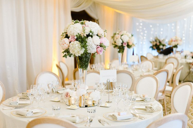 Pink & White Floral Centrepiece | Blush Flower Filled Wedding Reception at Pennyhill Park, Surrey Planned by Something Blue Weddings | Anushe Low Photography | Reel Weddings Film