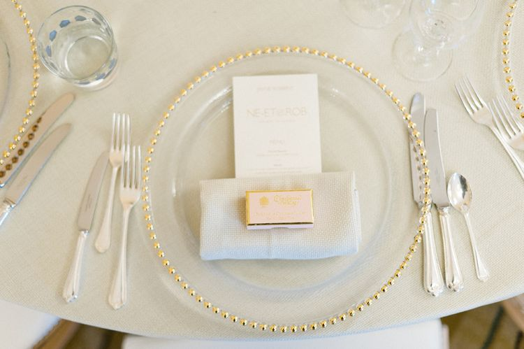 Charbonnel & Walker Wedding Favour | Glass Plate Place Setting | Blush Flower Filled Wedding Reception at Pennyhill Park, Surrey Planned by Something Blue Weddings | Anushe Low Photography | Reel Weddings Film
