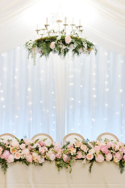 Fairy light Curtain, Hanging Floral Installation & Floral Table Runner Wedding Decor | Blush Flower Filled Wedding Reception at Pennyhill Park, Surrey Planned by Something Blue Weddings | Anushe Low Photography | Reel Weddings Film
