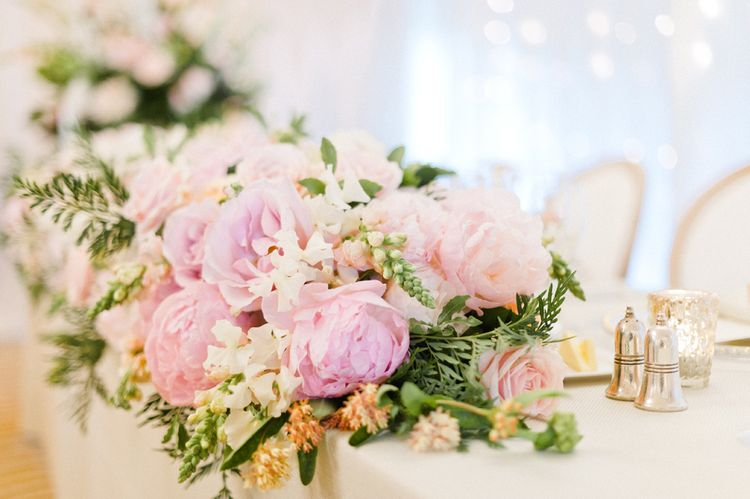 Pink Roses & Peony Top Table Floral Display by Blue Sky Flowers | Blush Flower Filled Wedding Reception at Pennyhill Park, Surrey Planned by Something Blue Weddings | Anushe Low Photography | Reel Weddings Film