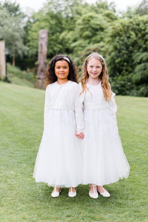 Flower Girls in White | Blush Flower Filled Wedding at Pennyhill Park, Surrey Planned by Something Blue Weddings | Anushe Low Photography | Reel Weddings Film