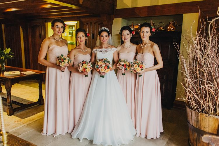 Bride in Suzanne Neville Heather Wedding Dress | Bridesmaids in Nude & Blush Mori Lee Gowns | Coral & Green Wedding at The Italian Villa in Poole, Dorset with Japanese Gardens | Peppermint Love Photography | Wedding Memories Film