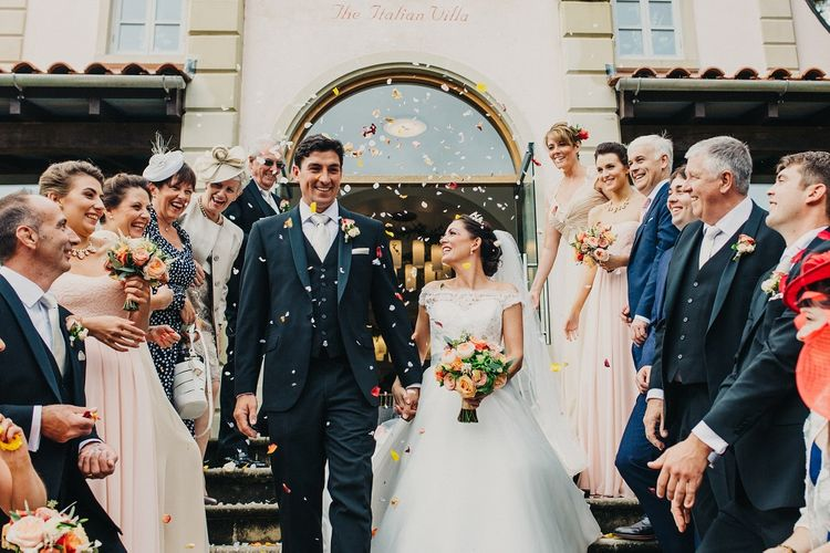 Confetti Moment | Bride in Suzanne Neville Heather Wedding Dress | Groom in Tuxedo | Coral & Green Wedding at The Italian Villa in Poole, Dorset with Japanese Gardens | Peppermint Love Photography | Wedding Memories Film