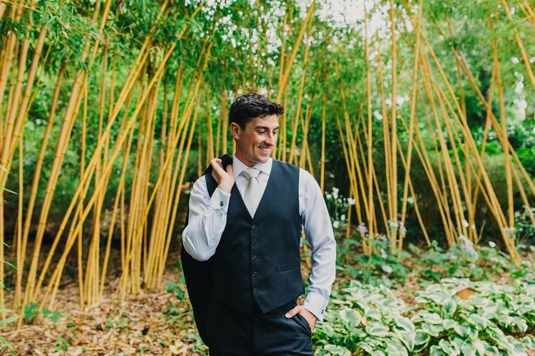 Groom in Tuxedo | Coral & Green Wedding at The Italian Villa in Poole, Dorset with Japanese Gardens | Peppermint Love Photography | Wedding Memories Film