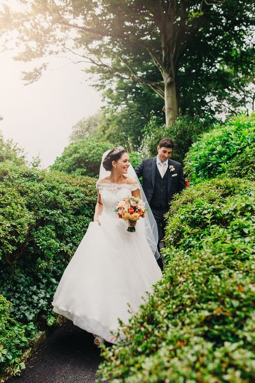 Bride in Suzanne Neville Heather Wedding Dress | Groom in Tuxedo | Coral & Green Wedding at The Italian Villa in Poole, Dorset with Japanese Gardens | Peppermint Love Photography | Wedding Memories Film