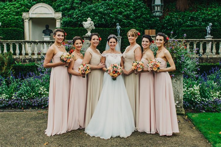 Bride in Suzanne Neville Heather Wedding Dress | Bridesmaids in Nude Mori Lee Gowns | Coral & Green Wedding at The Italian Villa in Poole, Dorset with Japanese Gardens | Peppermint Love Photography | Wedding Memories Film