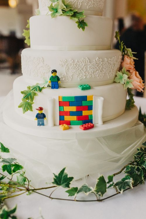 Sweetness & Delight Royal Icing Wedding Cake with Lego Decor | Bride in Suzanne Neville Heather Wedding Dress | Groom in Tuxedo | Bridesmaids in Nude More Lee Gowns | Coral & Green Wedding at The Italian Villa in Poole, Dorset with Japanese Gardens | Peppermint Love Photography | Wedding Memories Film