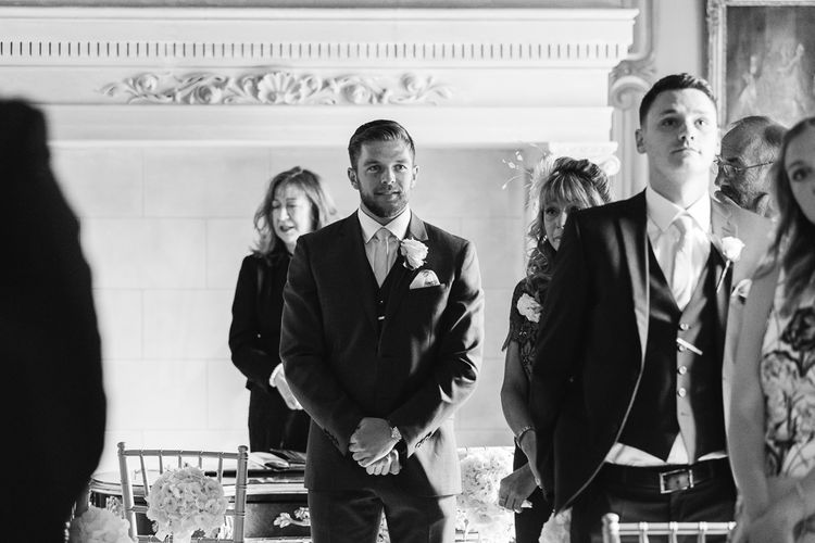 Groom at the Altar in Reiss Navy Three Piece Suit