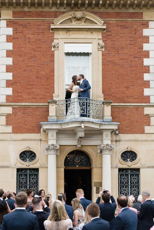 Bride & Groom Balcony Kiss at Fetcham Park in Surrey
