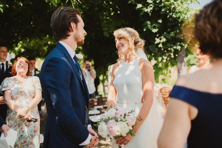 Outdoor Italian Wedding Ceremony at Borgo Petrognano Planned by Tuscan Wedding Planners| Frances Sales Photography