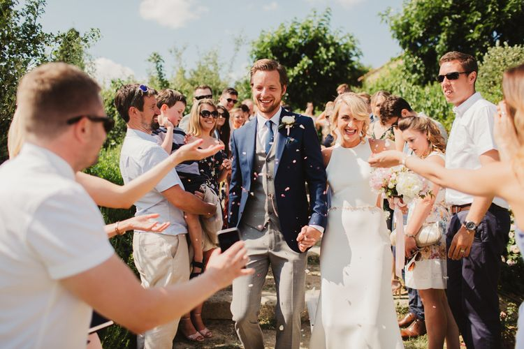 Confetti Moment | Bride in Sarah Seven Orleans Gown | Groom in Grey & Navy Suit | Frances Sales Photography