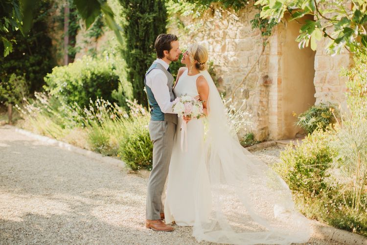 Bride in Sarah Seven Orleans Gown | Groom in Grey & Navy Suit | Frances Sales Photography