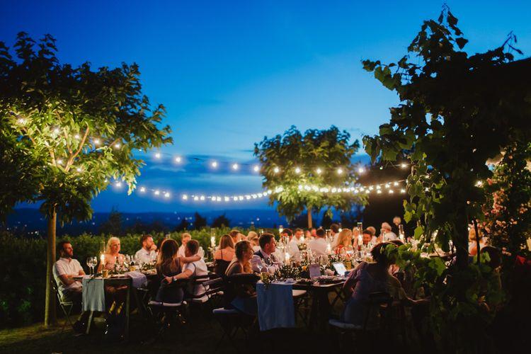 Festoon Lights | Al Fresco Dining | Outdoor Italian Wedding at Borgo Petrongnano | Frances Sales Photography