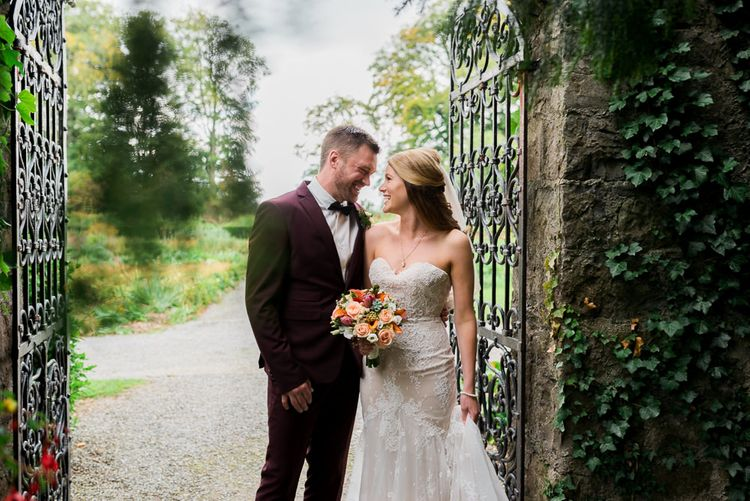 Bride in Lace Sweetheart Neckline Dress | Groom in Burgundy Suit | Kathy Silke Photography