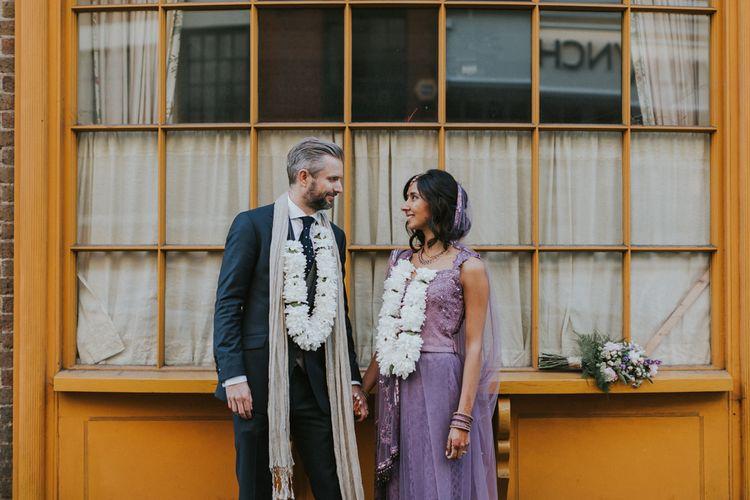 Bride In Lavender Sari & Groom In Reiss Suit