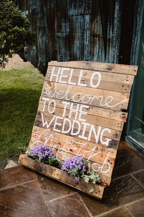 Wooden Palette Welcome Sign | Lilac & Navy Rustic Wedding at Stone Barn, Cotswolds | Frankee Victoria Photography