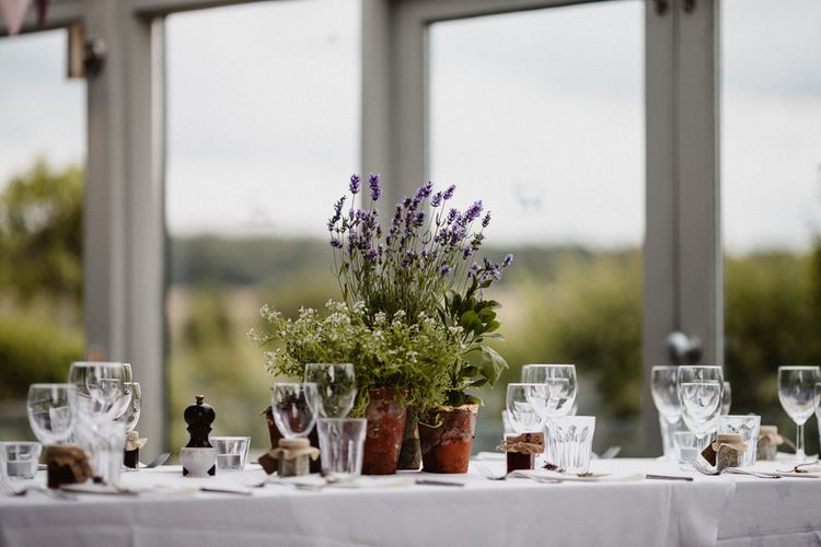 Wild Flower Plant Pot Centrepieces | Lilac & Navy Rustic Wedding at Stone Barn, Cotswolds | Frankee Victoria Photography