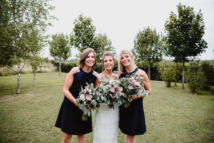 Bride in Claire Pettibone Bridal Gown | Bridesmaids in Navy Dresses | Lilac & Navy Rustic Wedding at Stone Barn, Cotswolds | Frankee Victoria Photography