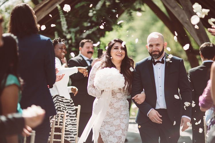 Confetti Moment | Bride in Grace Loves Lace Wedding Dress | Groom in Tuxedo | Lemonade Pictures