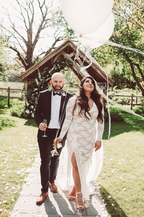 Bride in Grace Loves Lace Wedding Dress | Groom in Tuxedo | Giant Balloons | Lemonade Pictures