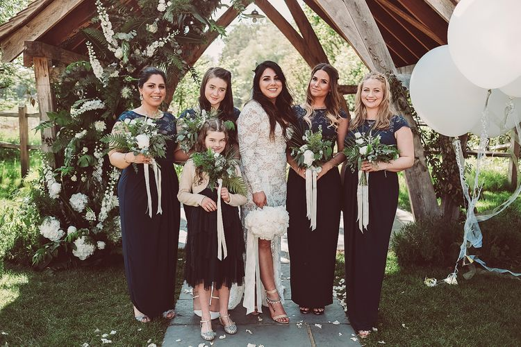 Bride in Grace Love Laces Wedding Dress | Bridesmaids in Navy ASOS Dresses | Outdoor Wedding at Millbridge Court | Lemonade Pictures