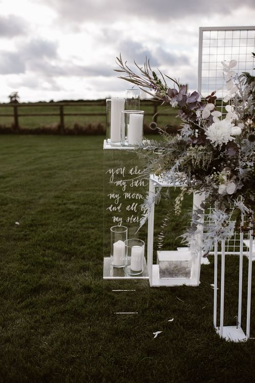 White & Grey Flowers by Swaffham Florist | Etched Perspex Altar Plinths | Nocturn Wedding Inspiration Planned & Styled by The Little Lending Company | Agnes Black Photography | Film by The Wilde Bride