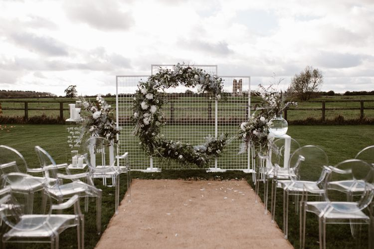 Aisle & Altar Style | Moon Gate Floral Arch by Swaffham Florist | Ghost Chairs | Nocturn Wedding Inspiration Planned & Styled by The Little Lending Company | Agnes Black Photography | Film by The Wilde Bride