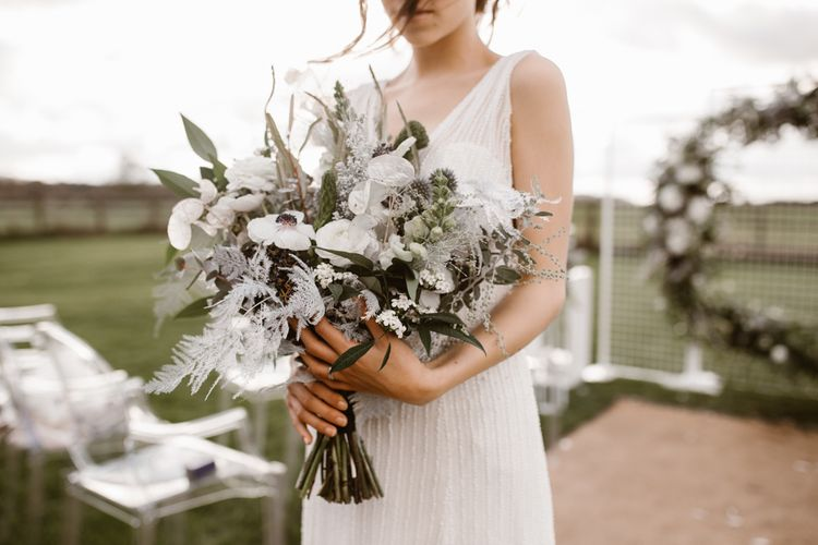 White & Grey Wedding Bouquet by Swaffham Flowers | Bride in Watters Wtoo Bridal Gown | Nocturn Wedding Inspiration Planned & Styled by The Little Lending Company | Agnes Black Photography | Film by The Wilde Bride