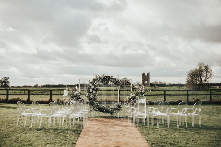 Moon Gate Altar | Ghost Chairs | Perspex Pew Ends | Nocturn Wedding Inspiration Planned & Styled by The Little Lending Company | Florals by Swaffham Florist | Photography & Film by The Wilde Bride