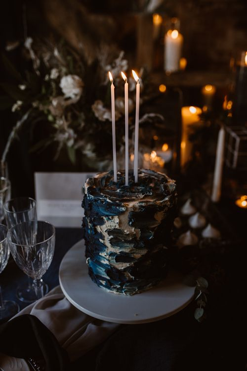 Inky Blue Buns of Fun Bakery Cake with Taper Candles | Nocturn Wedding Inspiration at Godwick Great Barn Planned & Styled by The Little Lending Company | Agnes Black Photography | Film by The Wilde Bride