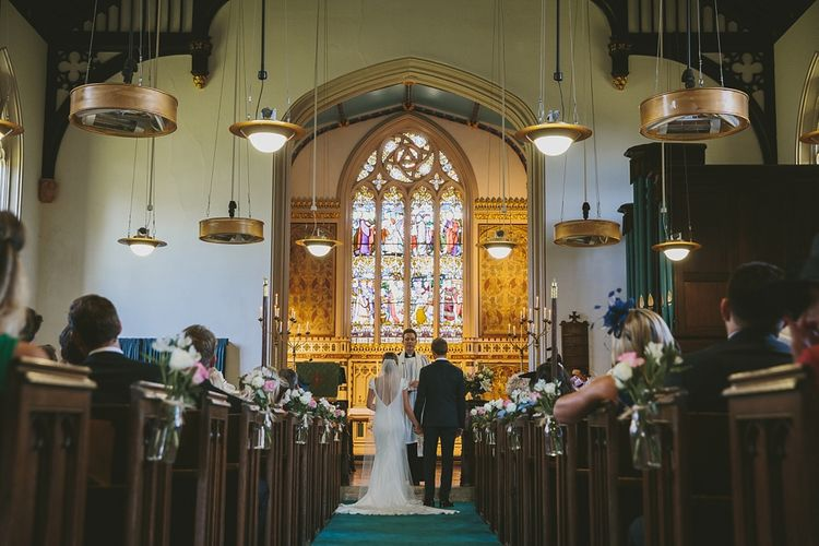 Church Wedding Ceremony with Aisle Flowers & Hanging Lights